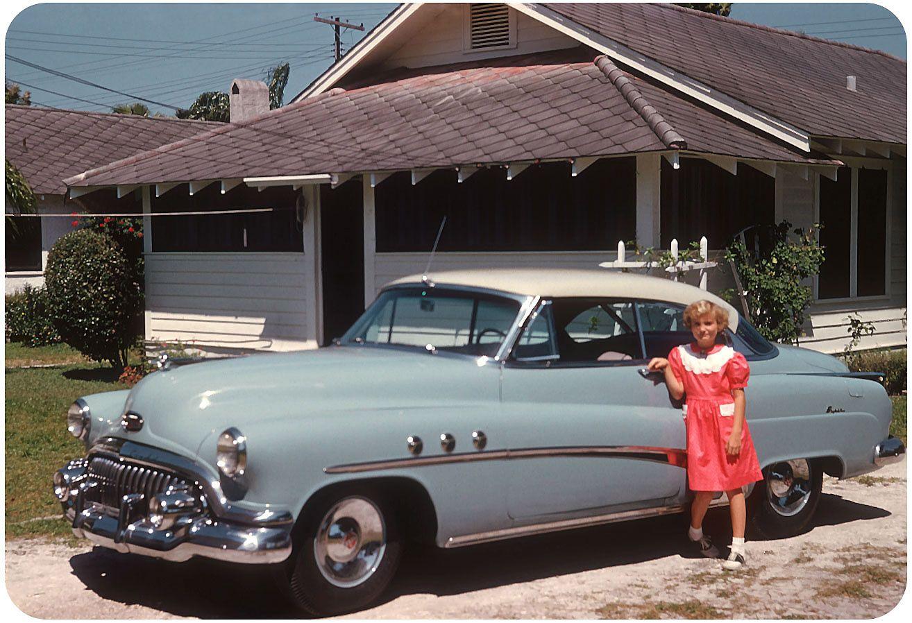 A familys kodachrome slide of a 1952 buick super taken