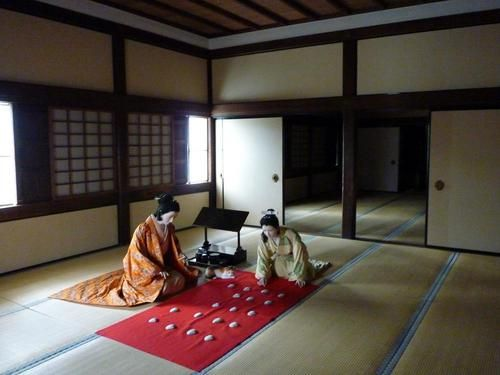 Life sized dolls of Senhime and a lady in waiting playing kai-awase in the Nishi-no-Maru room of Himeji-jo Castle in Hyogo Prefecture near Osaka.