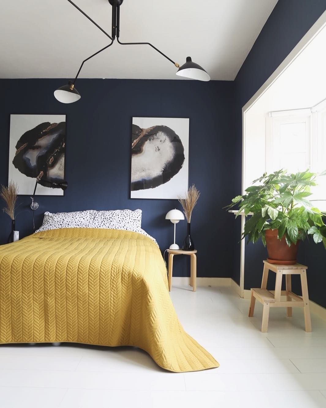 The bright yellow bedding adds the perfect contrast against those ...