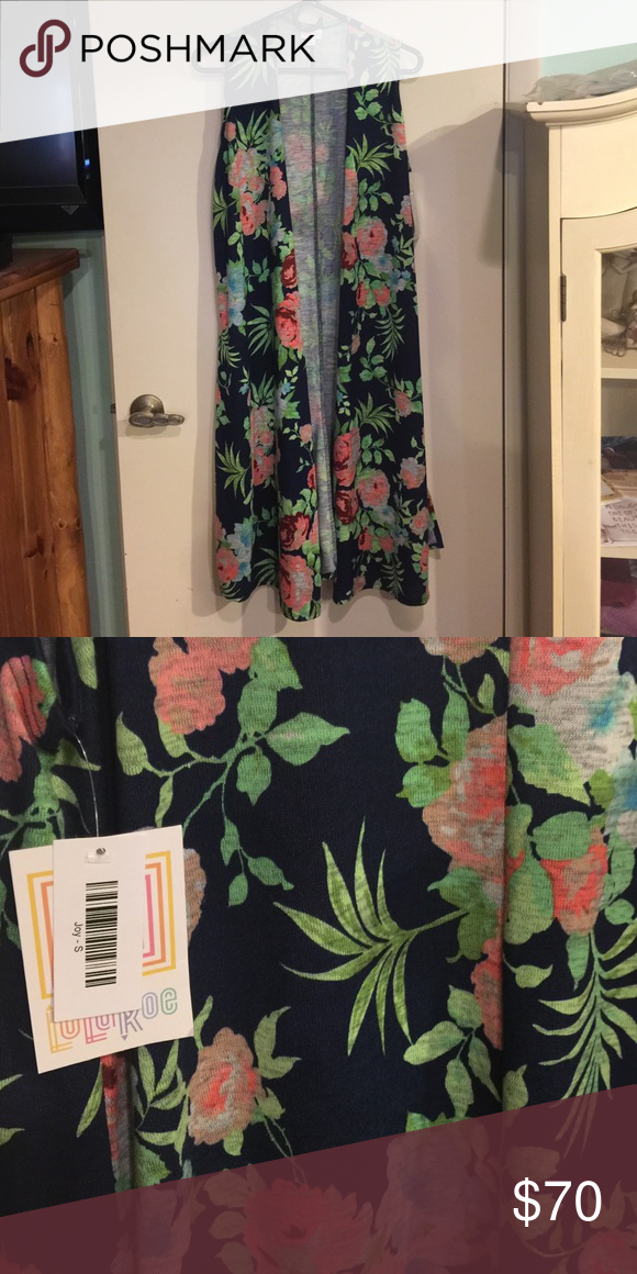 LulaRoe S Joy Beautiful LulaRoe Joy. Size small BNWT. Rare print. Multi colored, would go with so many things! Looks great over any dress, tunic/ legging combo, or even swim suit cover- up. Colors- navy background, light green, coral, burgundy, turquoise and grey. You'll love this!! ❤️ LuLaRoe Sweaters Cardigans