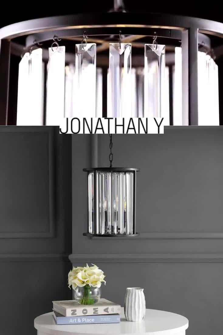 This geometric ceramic table lamp sits on a gold leaf base. #JonathanY #HomeDecor #Lamps #DesignerLamps #ModernLighting #CeilingLighting #PendantLighting