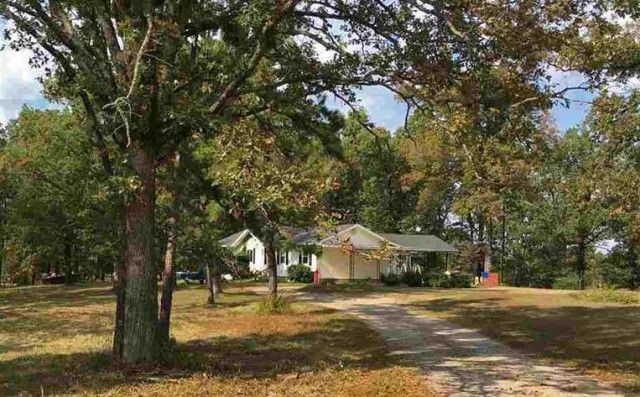 Large well maintained home on 9.75 acres m/l at the edge of historic Calico Rock, Arkansas set back from paved Hwy 5 South. Small pasture, large hardwood trees, land lays level and has a 24x34 pole barn, 20x14 workshop & small chicken house. Home has central heat & air, 3 large bedrooms and 2 baths. Great open floor plan with over 1,900 sq. feet of living space. Shopping and great schools in the Calico area, home located close to lake Norfork the White River & National Forest in Calico Rock…