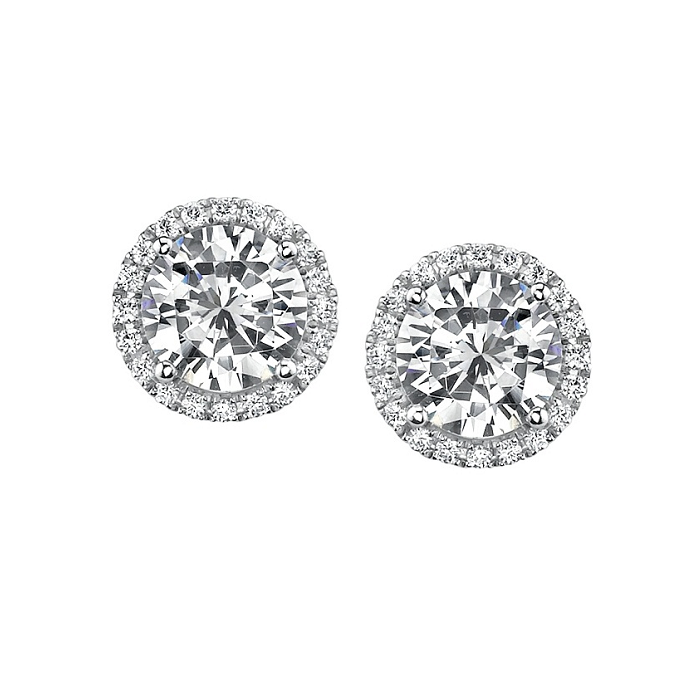 612153d91 Every girl needs at least one pair of beautiful diamond stud earrings -  perfect for day and night. These are White Gold Diamond Earrings by Brown  Jewelers