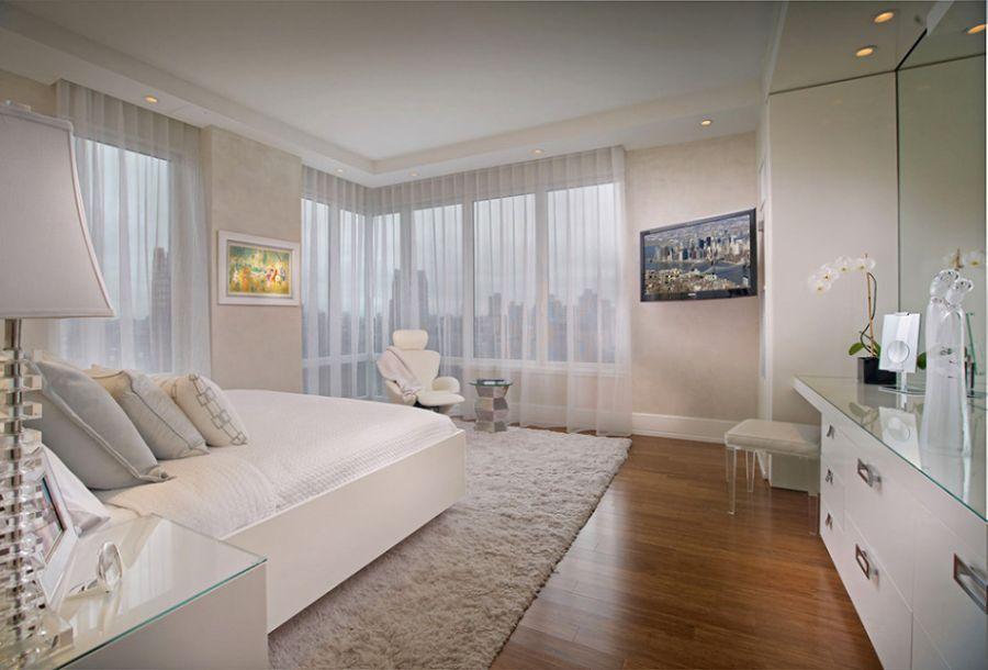 Interior Elegant Pepe Calderin Design Of New York City S In Bedroom Featuring Parquet Floor Master Bed Soft Carpet Ceiling Lamp And White