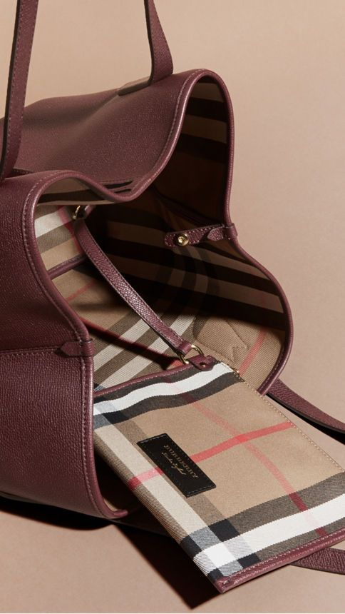 527ea16945c7 A softly structured Burberry tote bag in Mahogany Red and supple grainy  leather. Spaciously sized