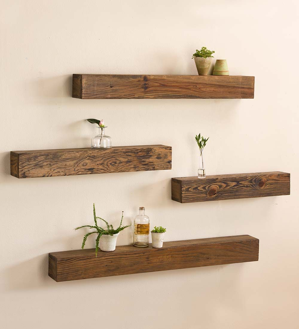 Rustic wooden shelf display your favorite photographs candles and more create your own art gallery with these versatile shelves in the living room