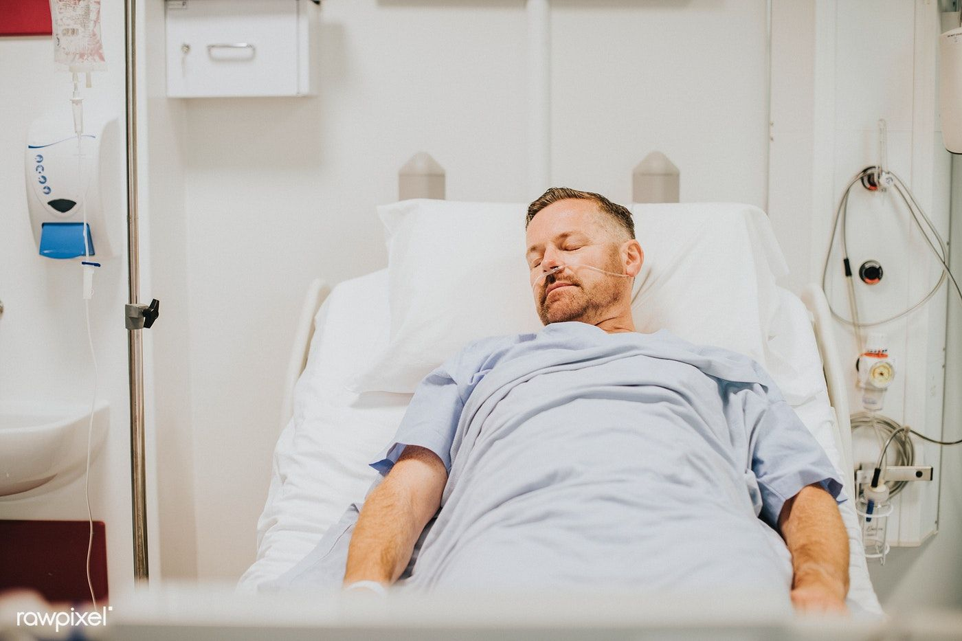 Download premium photo of Sick man in a hospital bed
