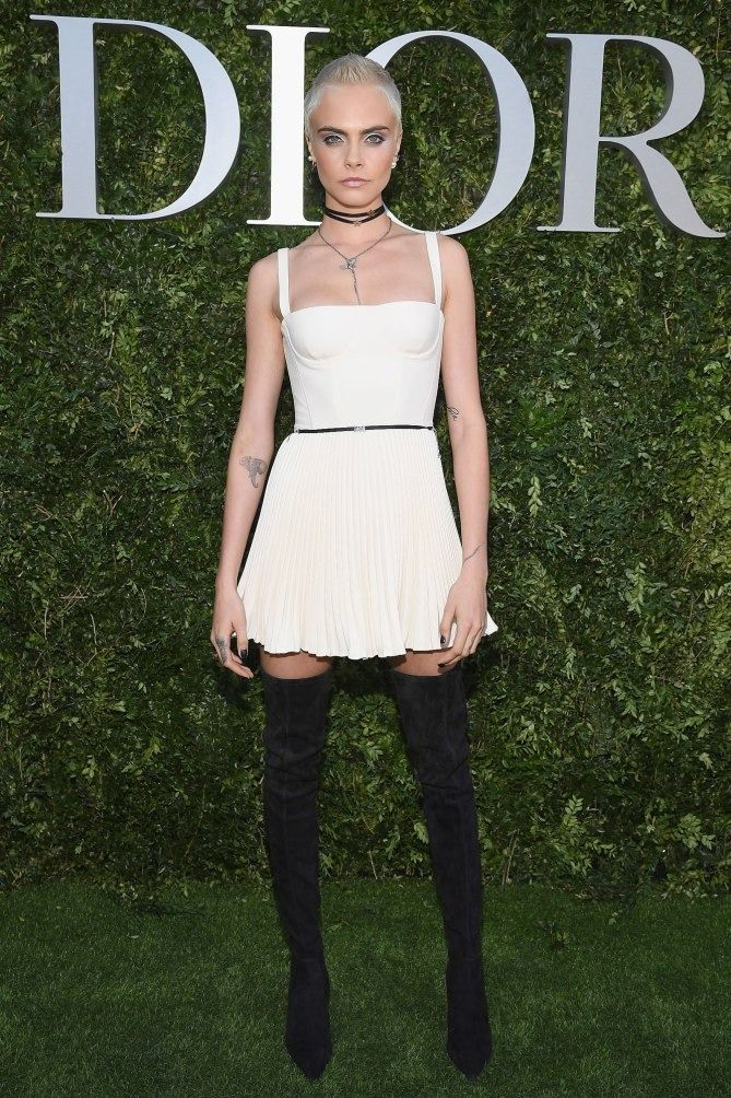 51138a1e0aea Paris Haute Couture Week 2017 Celebrity Photos - Cara Delevingne in a white  Dior mini dress and black over-the-knee boots