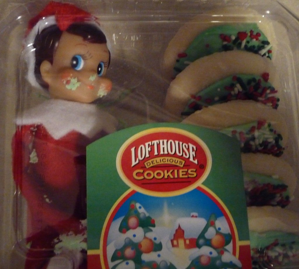 our SNEAKY elf, stealin' a cookie ... and then got stuck in the box!