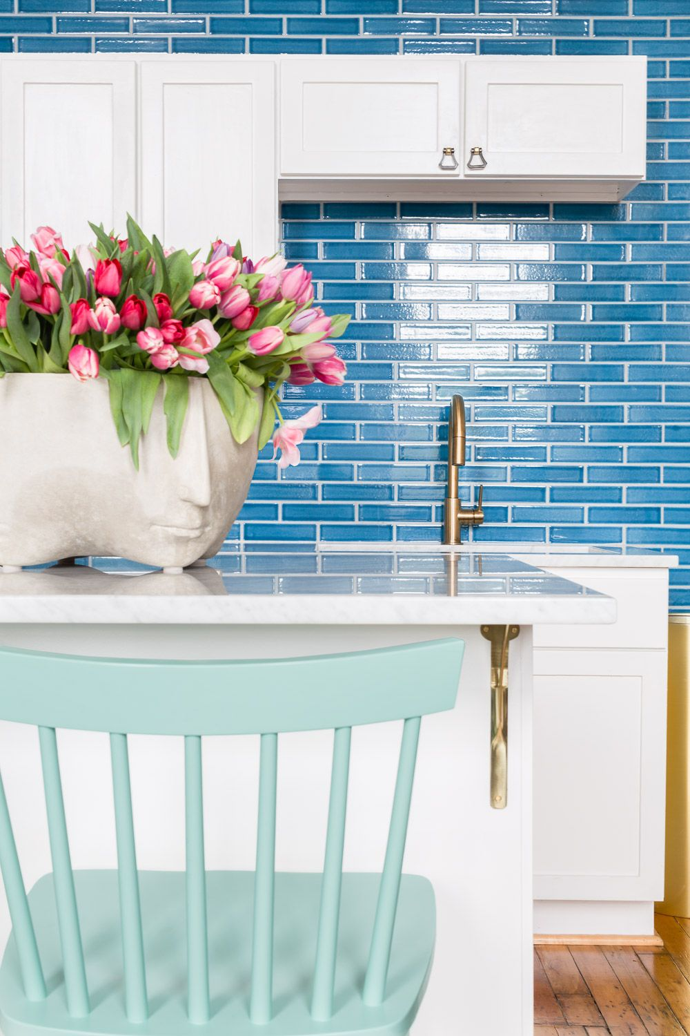 Colorful kitchen with white cabinetry, gold faucet, cobalt blue ...