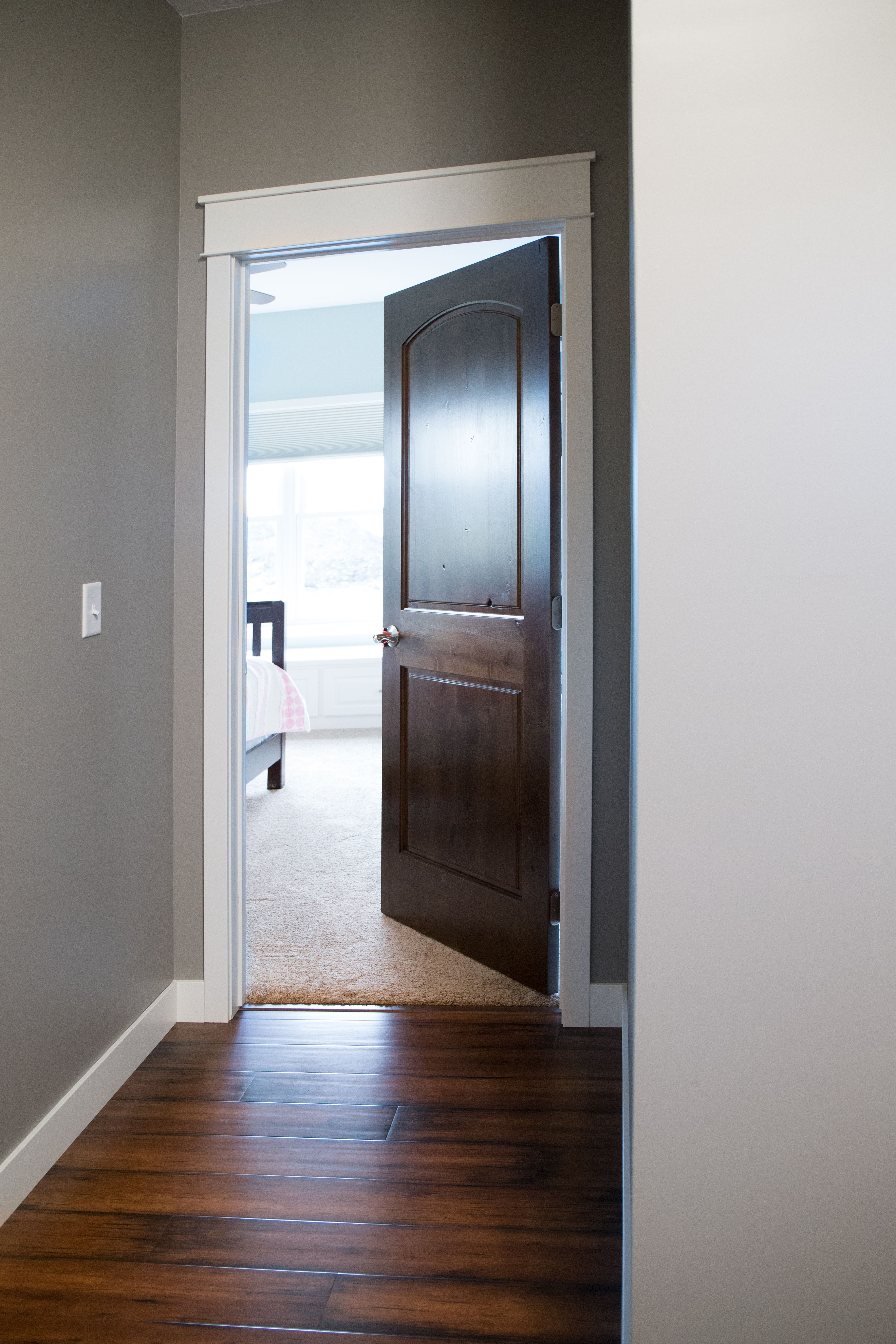 Interior Doors white trim and door topper, paired with a