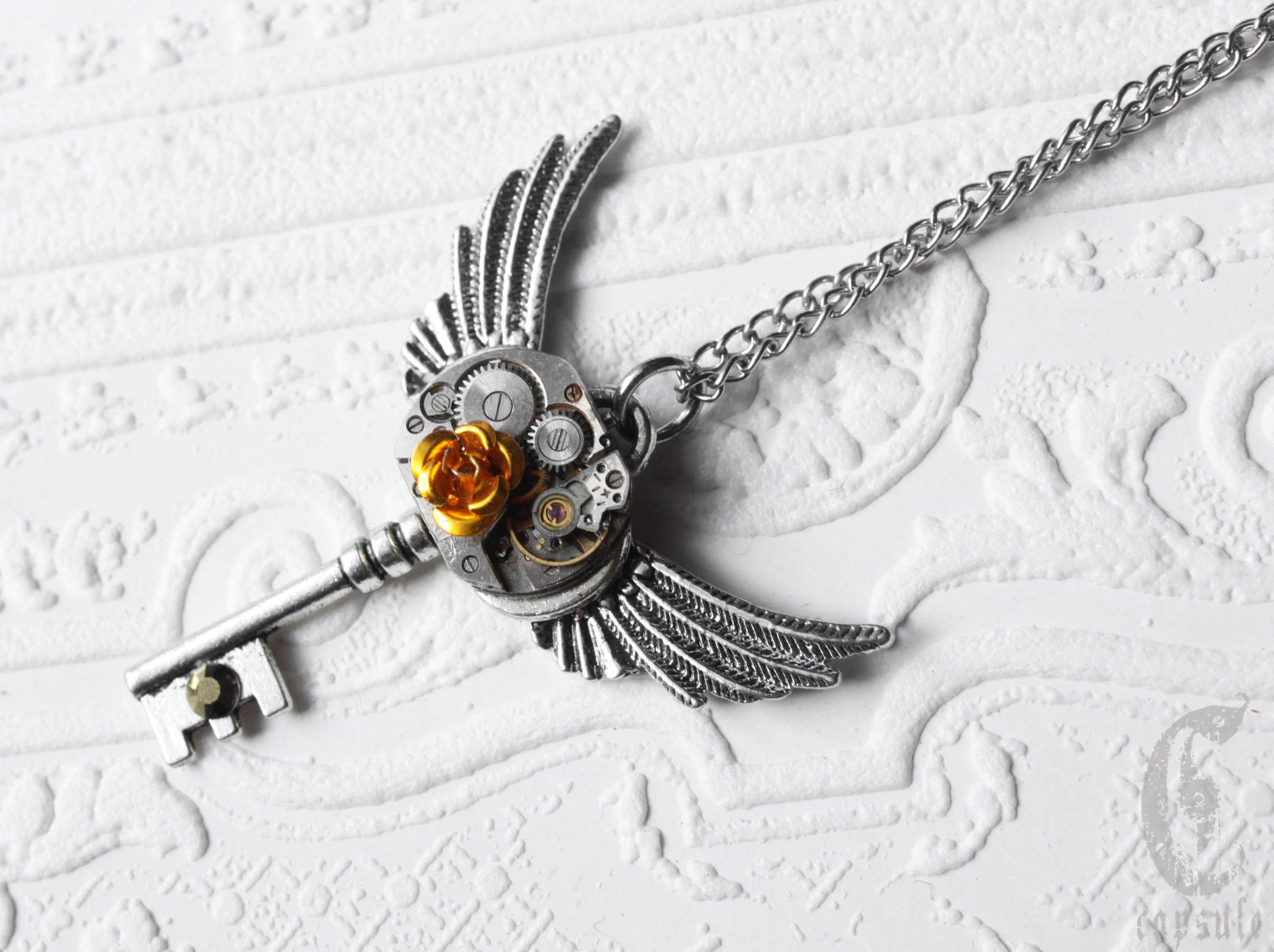 Antique silver steampunk skeleton key pendant necklace with wings