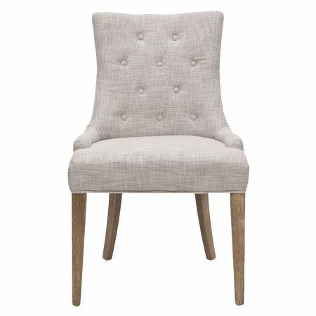 Bring eye-catching style to your living room or study with this lovely side chair, featuring tufted linen upholstery and pickled oak-finished legs.
