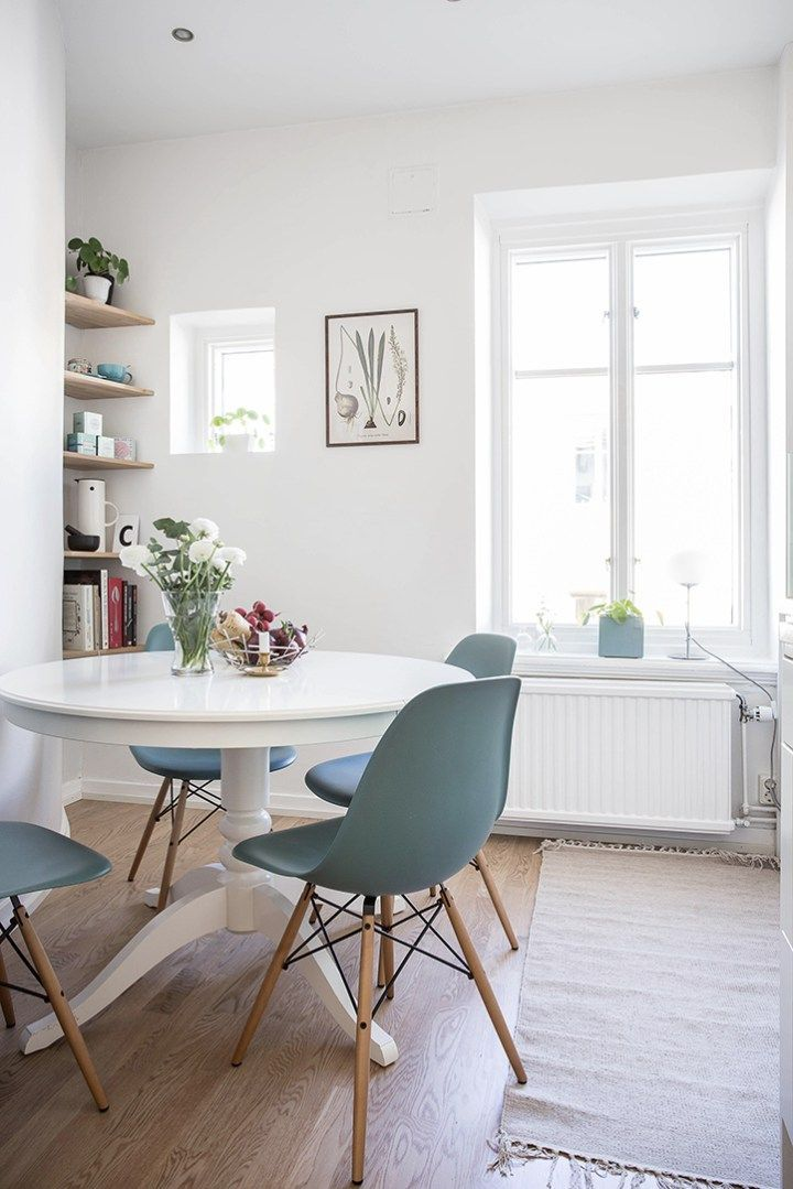 Cute White Bright Dining Room With Ikea Round Table Blue Chairs