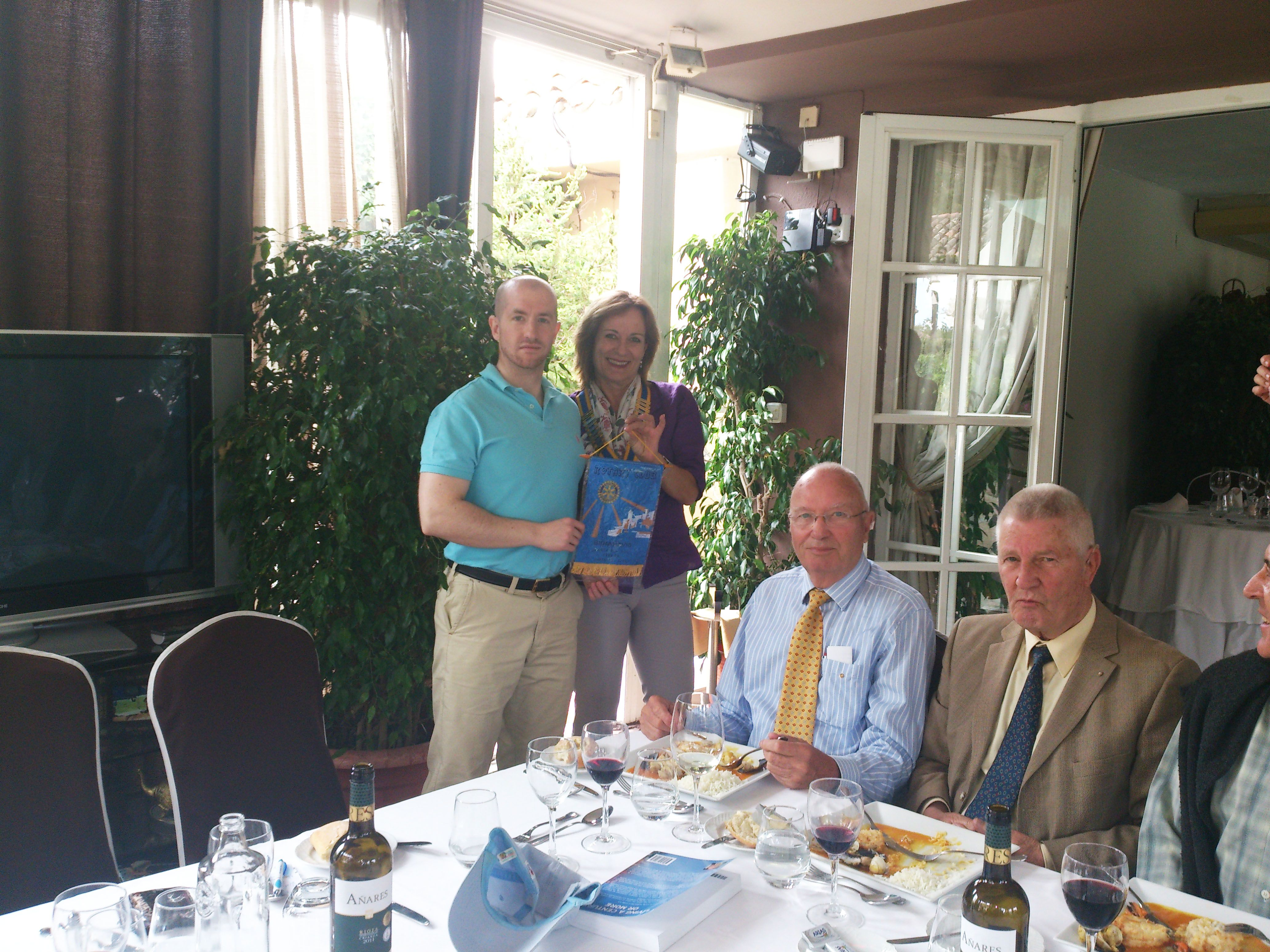 Prince Jorge Rurikovich receives signed badge from President and members of Rotary Club, Marbella, Spain