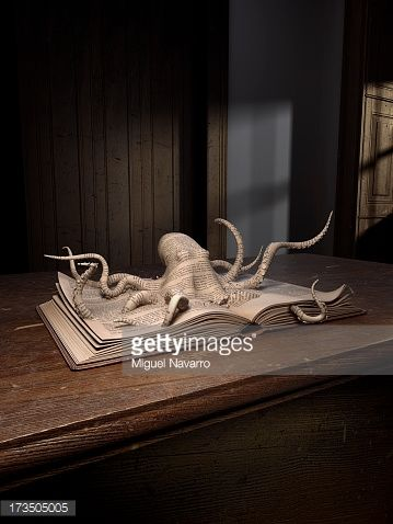 Stock Photo : Octopus popping up from an old book