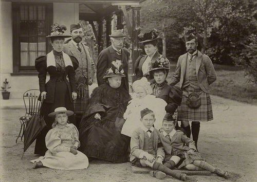 Queen Victoria and members of her family; from left to right, standing : Princess Helena Victoria of Schleswig Holstein, Prince Henry of Battenberg, Count Arthur Mensdorff - Pouilly (a maternal cousin of Queen Victoria's), Beatrice, Princess Henry of Battenberg, George, Duke of York and sitting, left to right: Princess Victoria Eugenie of Battenberg, Queen Victoria, Mary, Duchess of York holding Prince Edward of York, Prince Arthur of Connaught and Prince Alexander of Battenberg.