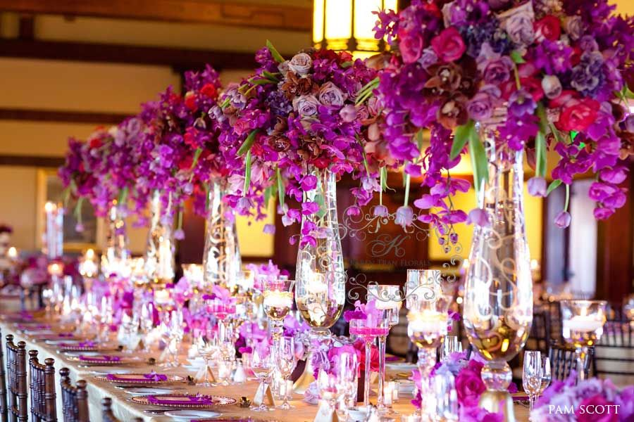 Long Head Table Filled With Towering Fl Centerpieces Lush In Varying Violet