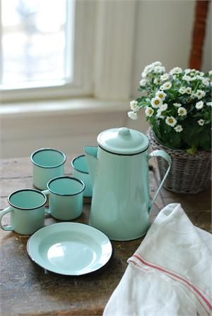 """This nine piece Enamelware Petite Serving Set in Robin's Egg Blue has tons of vintage charm. Reminiscent of a 1940s-style camp set, this sweet enamelware collection includes a coffee pot, four small plates and four small cups. The compact size makes this set perfect for tailgating and picnics or for display in any farmhouse kitchen. Food Safe. Pot: 6""""H x 4""""Diam and holds 32oz, Plate: 5.5""""Diam. Cup: 3.5""""H x 2.5""""Diam and holds 4oz."""