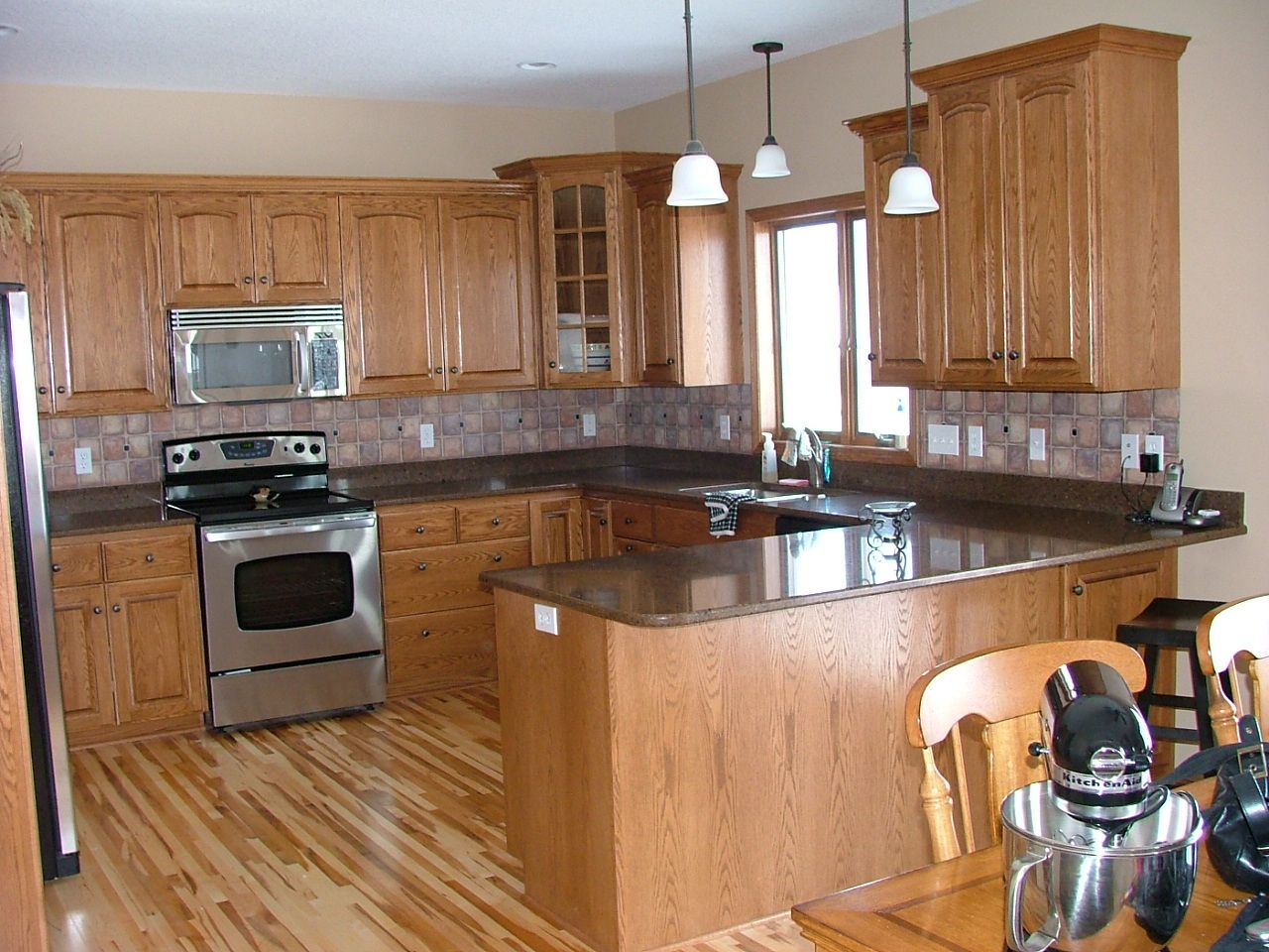 Backsplash Ideas For Light Oak Cabinets Part - 19: Kitchen, : Extraordinary U Shape Kitchen Decoration With Light Oak Wood  Kitchen Cabinet Including Black Granite Counter Tops And Light Brown Tile  Kitchen ...