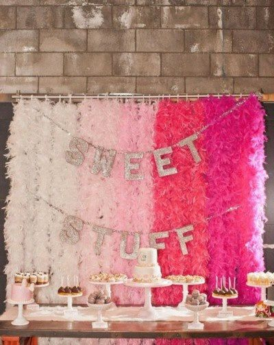 Love, love, love the feather boa's as a backdrop. Would work for a shower, birthday party or any event!