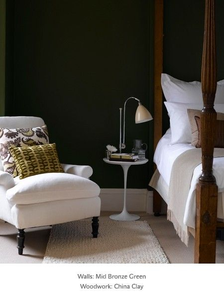 dark green bedroom walls with neutrals. Create a contrasting bedroom colour scheme.