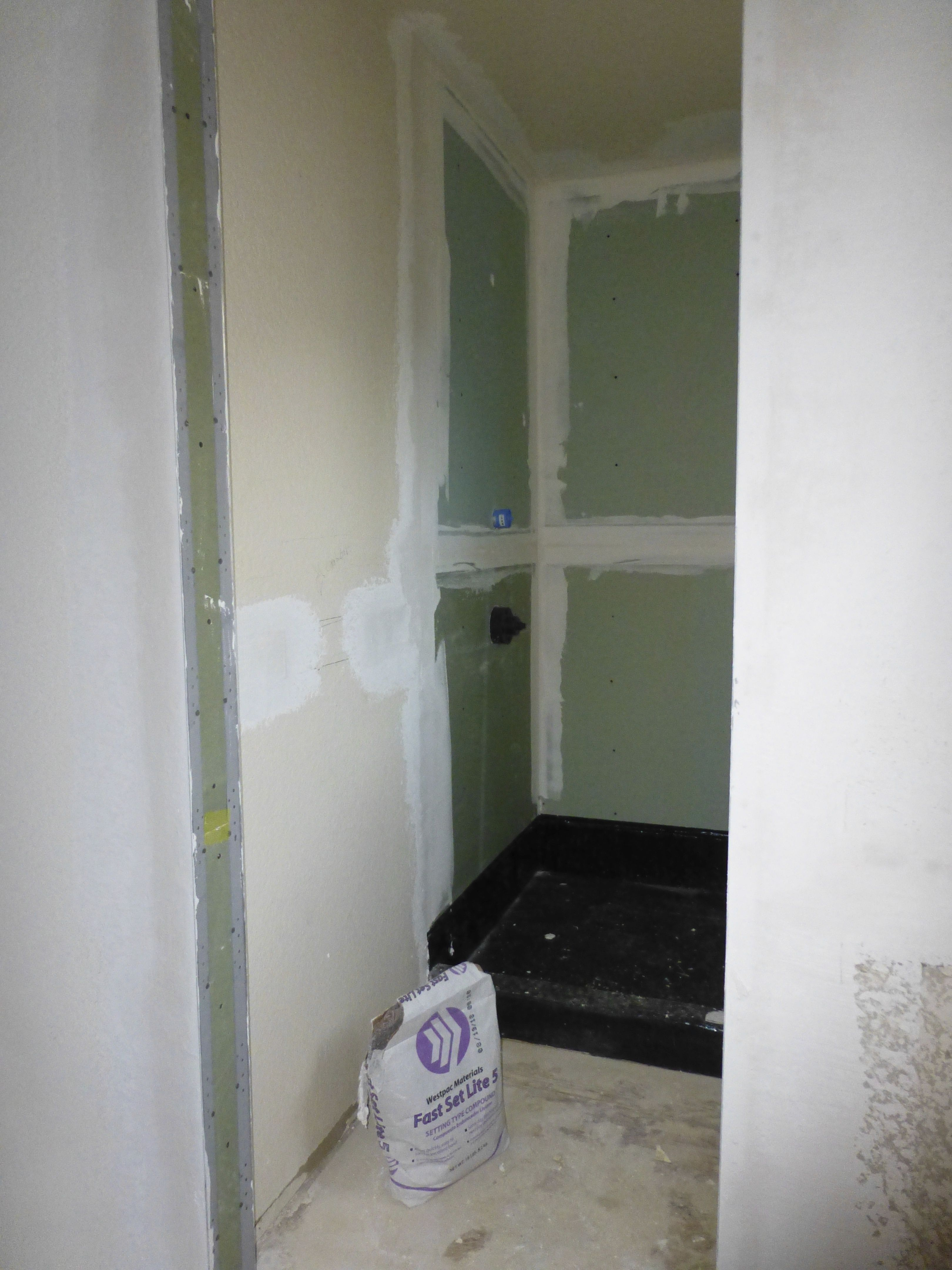 Day 6 Time For Greenboard This Is The Waterproof And Mildew Resistant Type Of Drywall Which Now Comes In The Co Mold Removal Cost Bathrooms Remodel Remodel