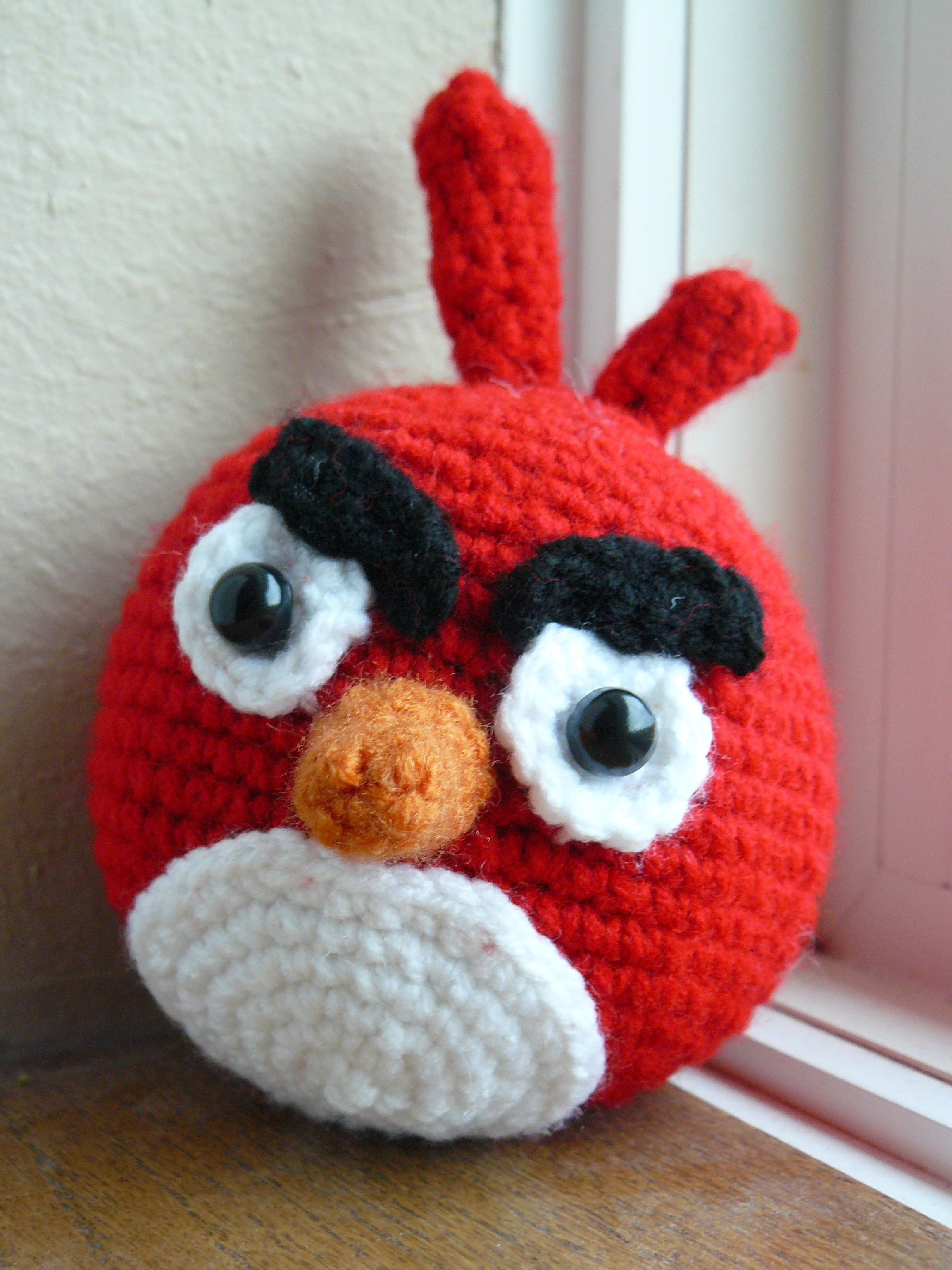 Crocheted red angry bird.