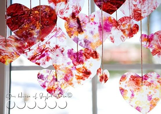 This is so cool and simple to do! Melt crayon between wax paper & cut out heart. Bet that would work with freezer paper too.