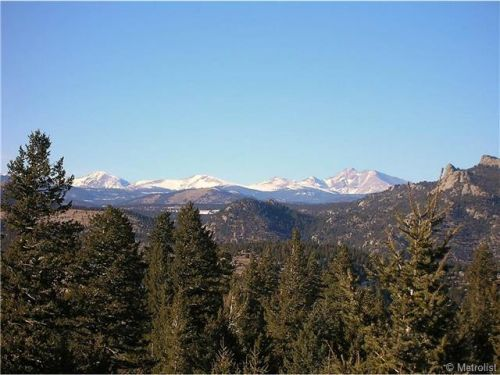 710 Tunnel 19 Rd Golden CO 80403, MLS #896069  70 virgin acres with rock outcroppings, Ponderosa, Fir and Aspen, just 20 minutes from cities of Boulder or Golden. Easy access! Private! Split into two 35 acre parcels. Views are to die for!!