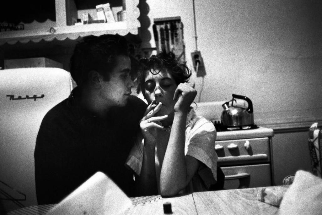 Teenager couple smoking at a kitchen table. New York City 1959, Brooklyn Gang by Bruce Davidson