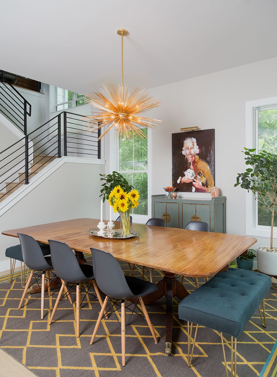 An antique mahogany dining table and a kelly wearstler chandelier play well together in this south austin dining room