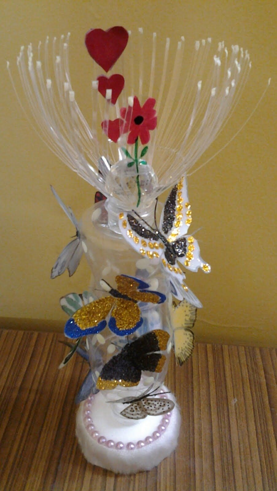 Best out of waste plastic cans bottles transformed to for Images of decorative items made from waste material
