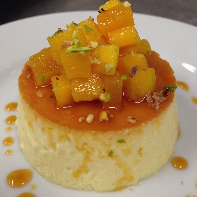 tropical flan... With mango coconut and pistachios this was there favorite wanted more #privateparty #flan #mango #pina #coconut #sexinyourmouth #goodeats #chefkelvin #cheflife #Padgram