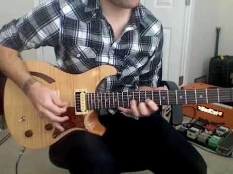 Jon demoing one of his guitars.