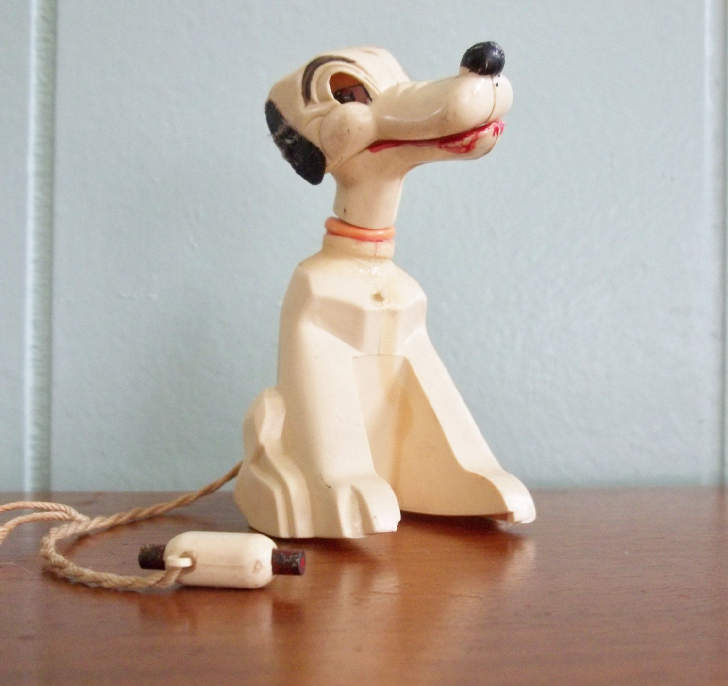 celluloid bobble head dog noddler dog s mouth opens to hold celluloid bobble head dog noddler dog s mouth opens to hold magnetic hot dog bone on string vintage toy home decor white dog with spots
