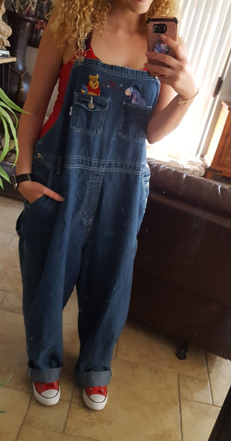 f1e8d07e61c 90s retro and vintage denim oversized Winnie the Pooh denim overalls (super  baggy) paired with a red tank top and some red leather converse sneakers.