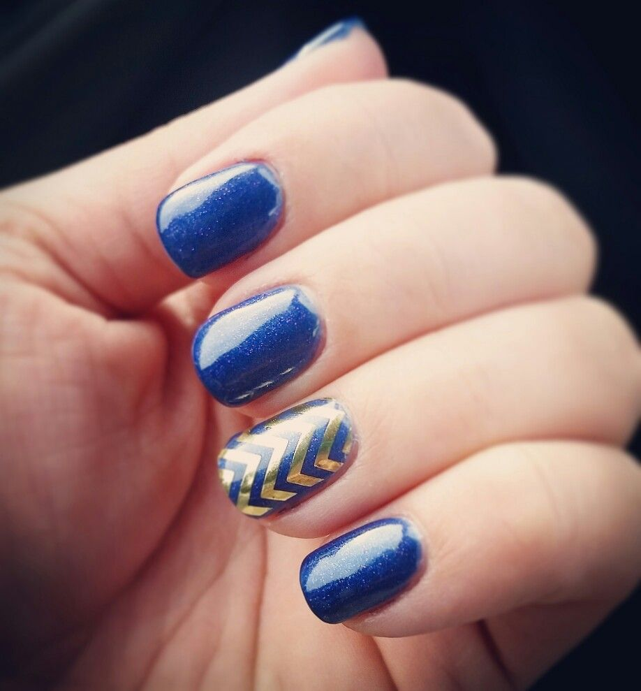 Manicure Done With Intergalactic Blue Gel And An Accent Of Gold Chevron Wrap Over He Gel As An Accent Www Cgeigerjams Jamberry Blue Gel Manicure Gold Chevron