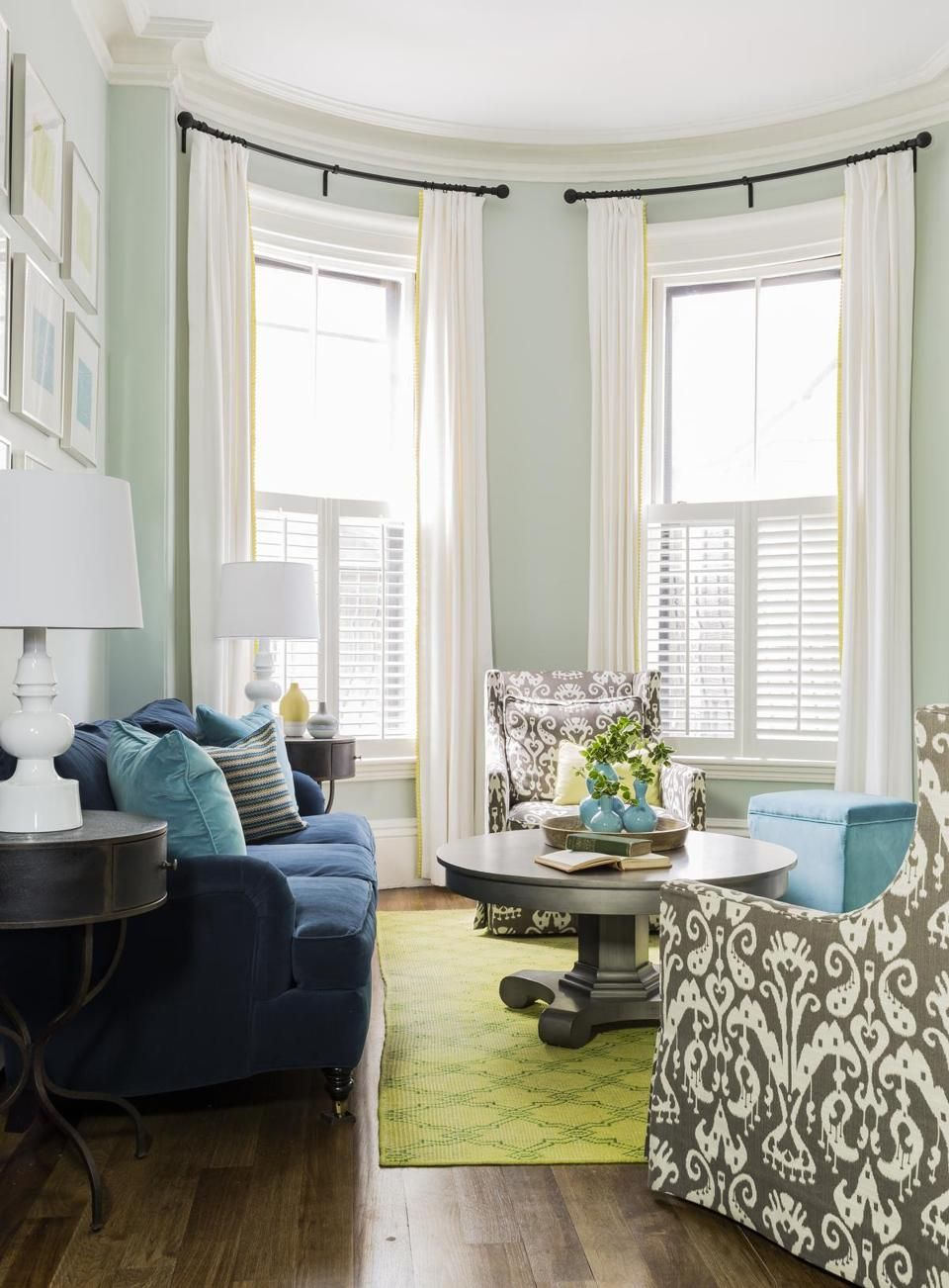 living room with light green carpet home decorating ideas curtains vertical in the south end boston globe spaces navy blue sofa gray ikat chairs teal walls lime painted coffee table ivory