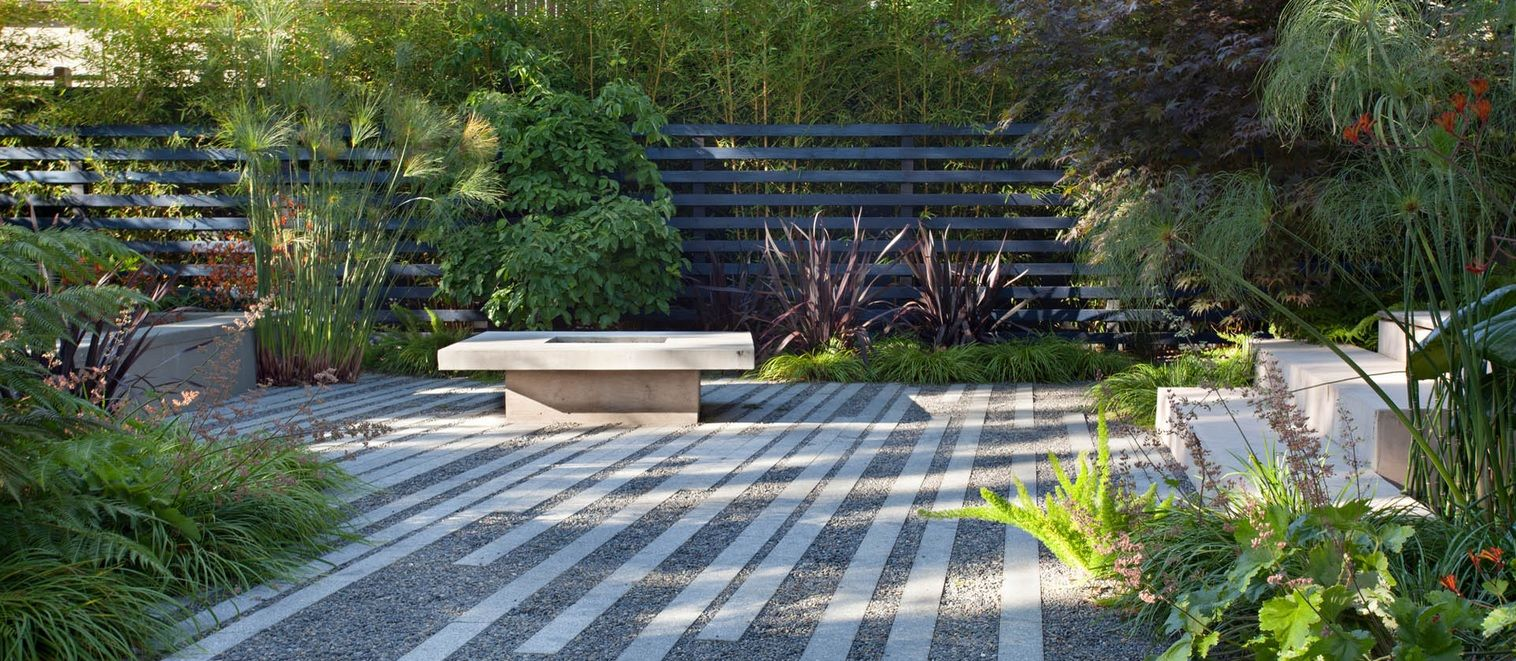 bernard trainor patio with linear bands of paving the ground