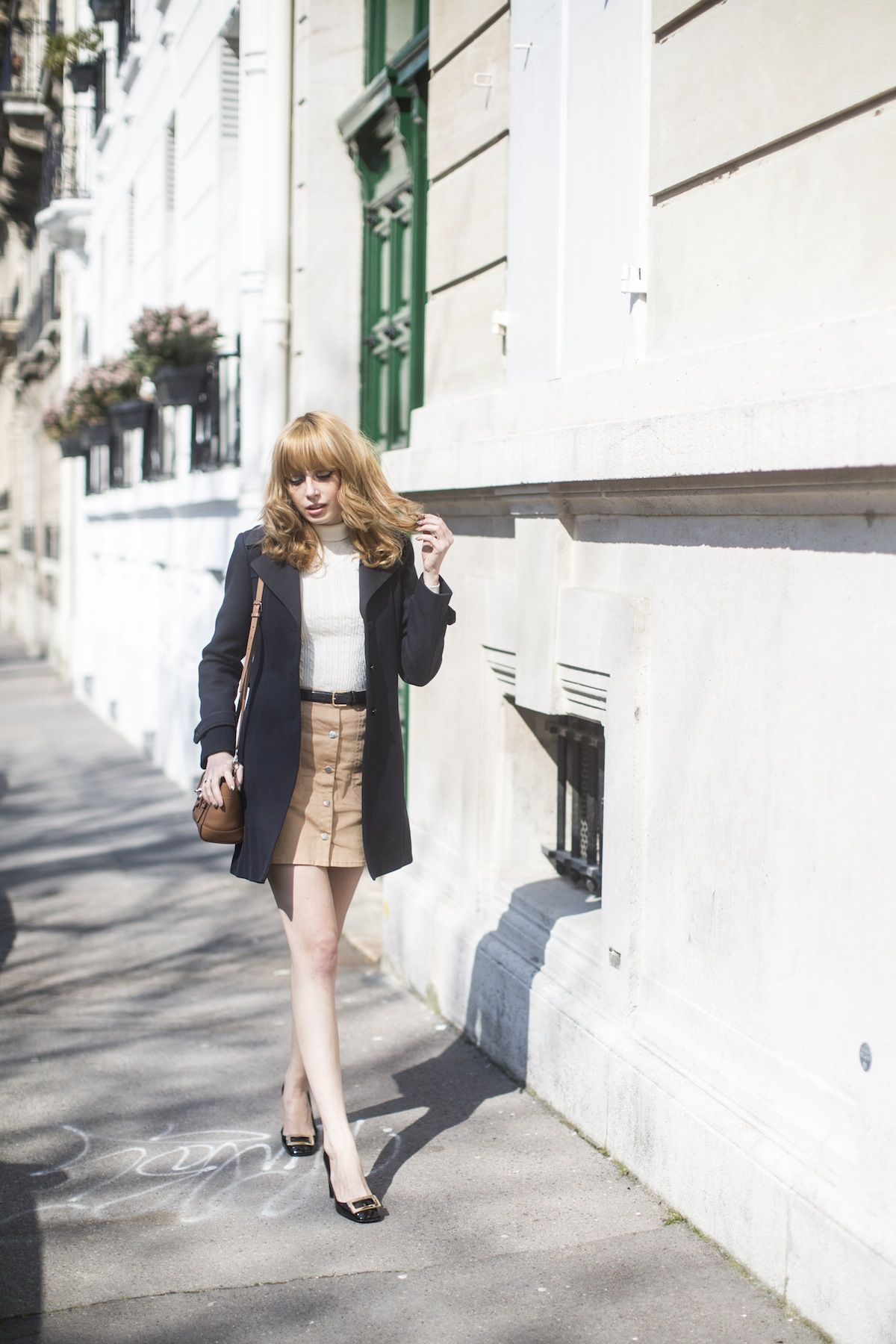 Louise Ebel in a cute tan button fronted skirt Skirt: Miss Patina, Coat: Pablo, Bag: Ralph Lauren, Shoes: Roger Vivier, Knit: Uniqlo