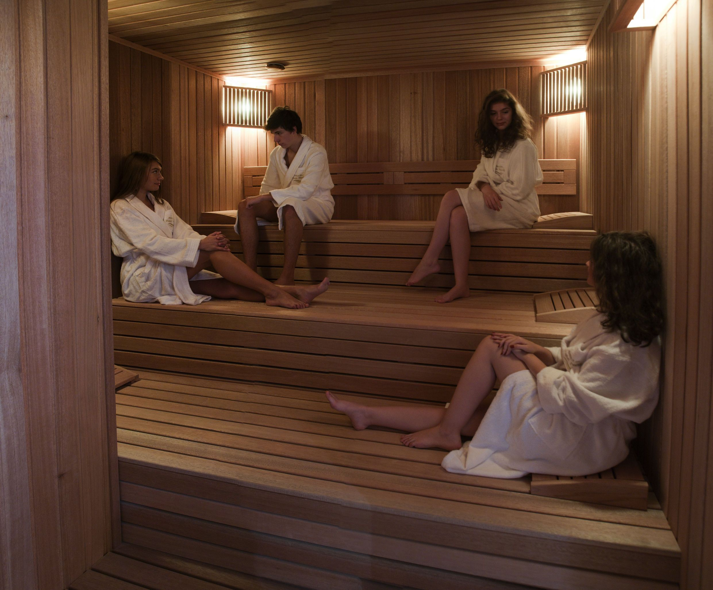 Couple In Towels Resting In The Sauna. Stock Photo - Image