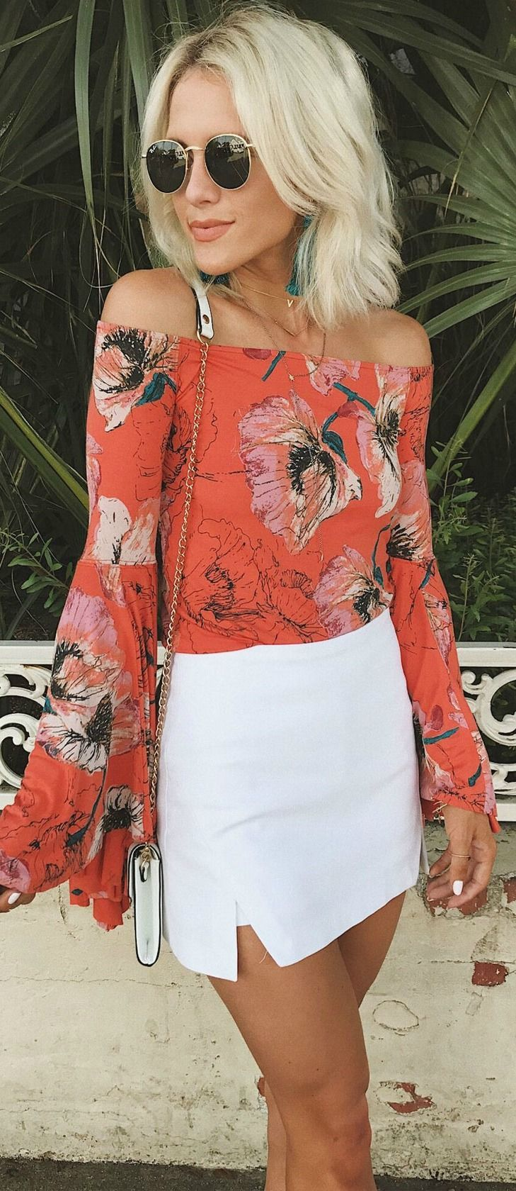 Free People Birds of Paradise Coral Orange Floral Print Top is part of Party Clothes Casual - Be the party in the Free People Birds of Paradise Coral Orange Floral Print Top! Soft and stretchy jersey knit, in a coral orange, pink, blue, and black floral print, shapes an offtheshoulder neckline, and long, dramatic bell sleeves  Fitted bodice  As Seen On Kemper of @joandkemp!