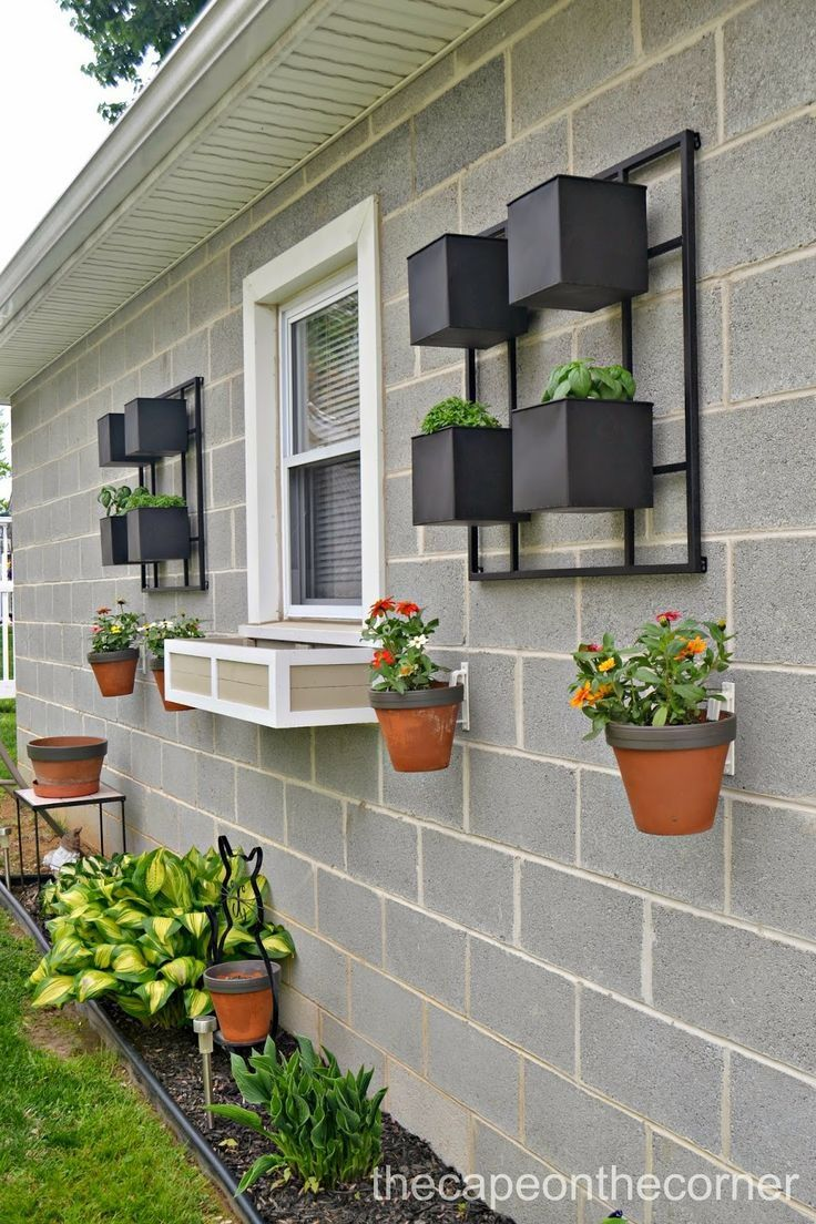 Design A Concrete Wall With Hanging Flower Pots Using
