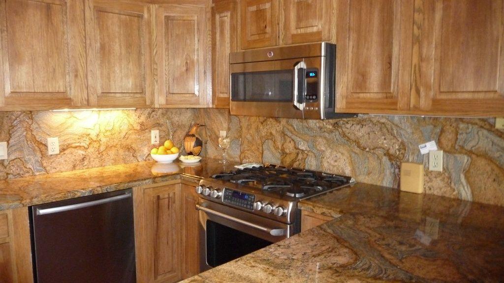 Pental Imperial Gold Polished Granite Counter Tops And Backsplash