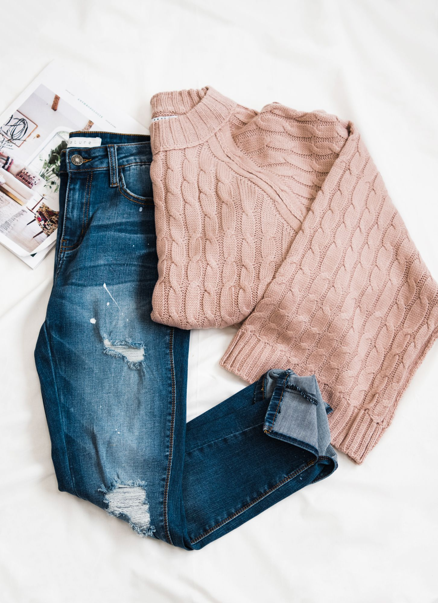 Cute knit sweater with trendy distressed denim jeans