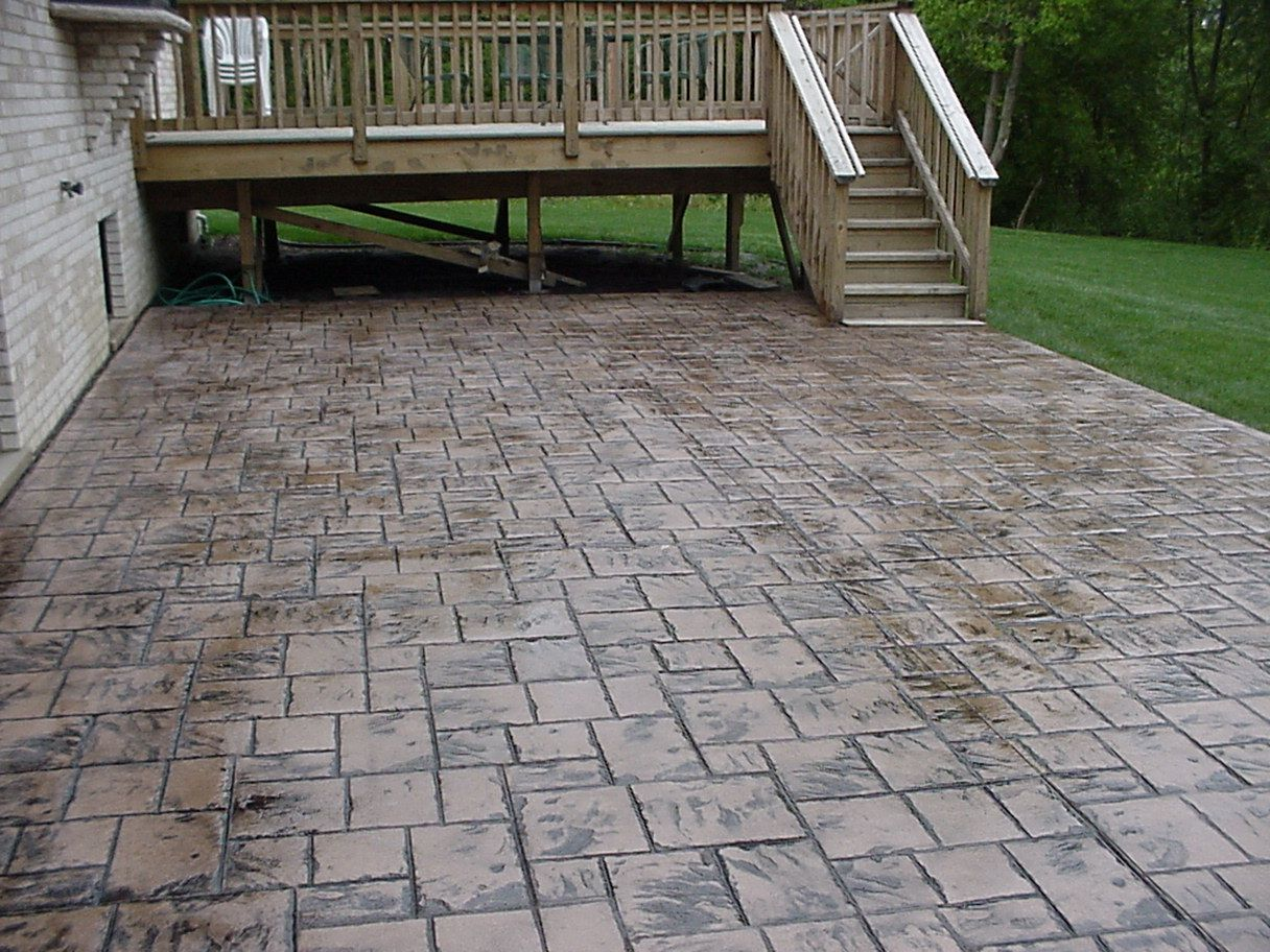 stamped concrete patio coming off of a simple deck just needs