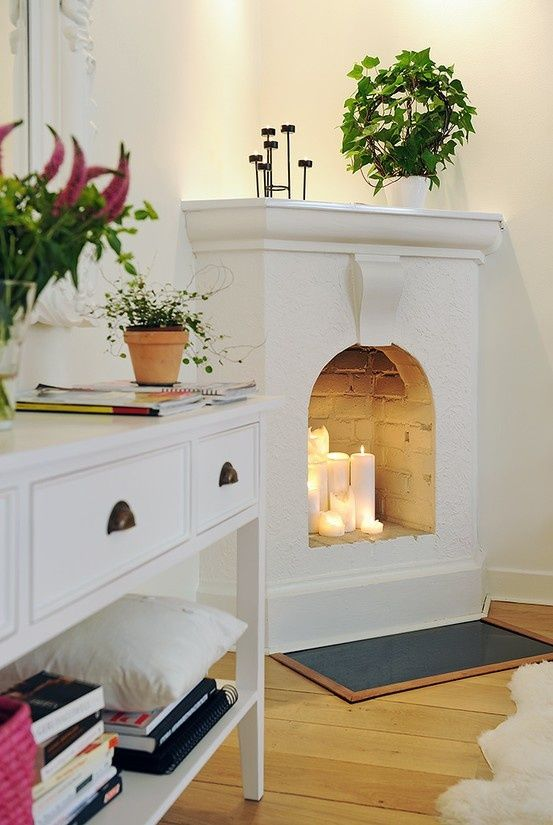 A fake fireplace with real candles. So pretty in a large master bathroom!