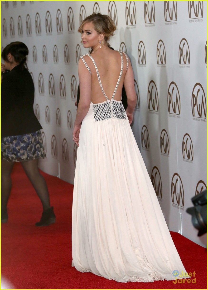 Jennifer lawrence is stunning in her floor length gown while walking