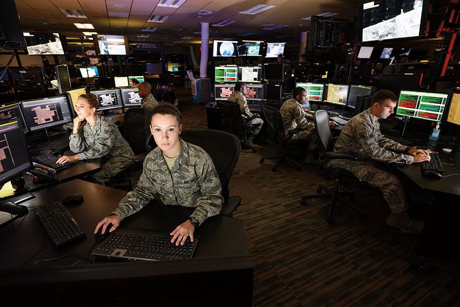 Airmen working on Distributed Ground Station1 Operations